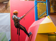 Young Boy Abseiling. Young boy learning to abseil Royalty Free Stock Photo