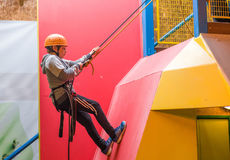 Young Boy Abseiling. Young boy learning to abseil Royalty Free Stock Images