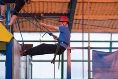 Young Boy Abseiling. Young boy learning to abseil Stock Photo