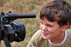 Young boy acting. Young boy actor with expressive face performing before the camera Stock Photos