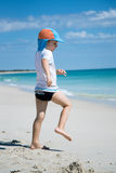 Young boy is acting like lifesaver. Young boy is acting like a lifesaver on a white sand beach in Perth, Western Australia Royalty Free Stock Image