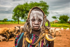 Young boy from the African tribe Mursi, Ethiopia royalty free stock photography