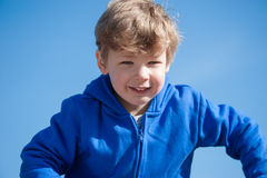 Young Boy against a Blue Sky Stock Photography