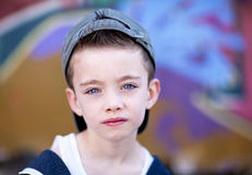 Young boy against graffiti wall Stock Images