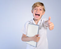 Young boy agree. Young boy with tablet agree Royalty Free Stock Images
