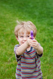 Young boy aiming a  water gun Royalty Free Stock Image