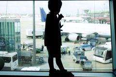 Young boy on airport window background Royalty Free Stock Photos
