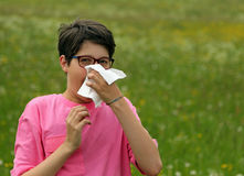 Young boy with allergy blows his nose Royalty Free Stock Photography