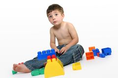 Young boy amongst building blocks Stock Photography