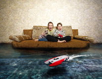 Free Young Boy And Girl With Radio Control. Stock Photography - 50445452