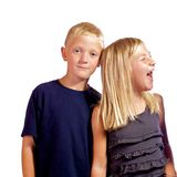 Young boy annoyed with sister. Royalty Free Stock Images