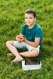 Young boy with apple in the hands Stock Photo
