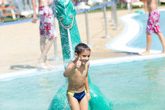 A young  Boy in aqua park. Child having fun in aqua park Royalty Free Stock Image
