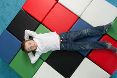Young boy with arms behind his head, Smiling child relaxing Stock Photos