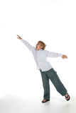 Young boy with arms outstretched. As if flying and balancing on one leg Stock Photo