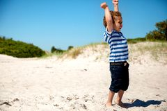 Young Boy  with Arms Stretched Looking Happy Stock Photos
