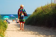 Arriving at the Beach. A young boy arrives to the beach in Montauk, Long Island carrying his boogie board Royalty Free Stock Photography