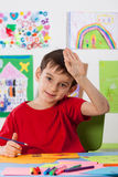 Young boy in the art lesson. Young smiling boy in the art lesson Stock Images