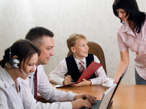 Young boy as a boss in the office with employees Royalty Free Stock Image