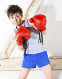 Young boy as a boxer. Young boy with red boxing gloves Royalty Free Stock Images