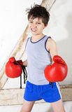 Young boy as a boxer. Young boy with red boxing gloves Royalty Free Stock Photography