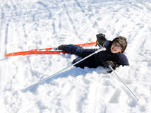 Young boy asks for help after the fall on skis. In winter Royalty Free Stock Images