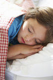Young Boy Asleep In Bed Stock Image