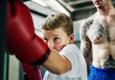 Young boy aspiring to become a boxer Stock Image