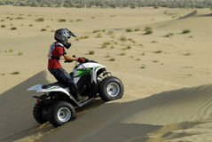 Young Boy in ATV. Young Boy Quad Biking in the desert Royalty Free Stock Images