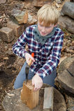 Young Boy with an Axe Cutting Firewood Royalty Free Stock Images