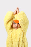 Young Boy in a baby chicken costume. A young boy is dressed up in a chicken costume Stock Image