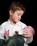 Young boy and baby looking at each other Stock Images