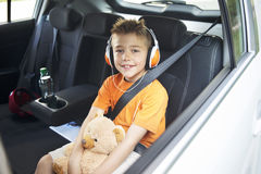 Young boy in the back seat of a car Royalty Free Stock Images