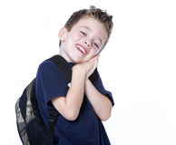 Young boy with backpack. A young boy with backpack studio portrait Stock Photos