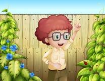 A young boy at the backyard Stock Photos