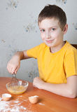 Young boy baking Royalty Free Stock Photos