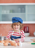 Young boy baking Stock Images