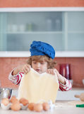 Young boy baking Royalty Free Stock Photo