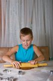Young boy baking cookies Royalty Free Stock Photography