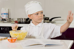 Young boy baking giving a perfect gesture Royalty Free Stock Images