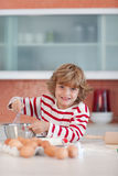 Young boy baking in the kitchen Stock Photos