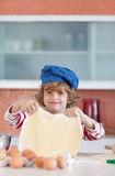 Young boy baking in the kitchen Royalty Free Stock Images