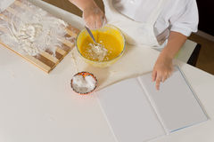 Young boy baking in the kitchen Stock Images