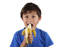 Young boy with banana Stock Photography