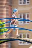 Young boy in bandana on playground Royalty Free Stock Photography