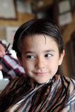Young boy at barber shop Royalty Free Stock Images