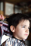 Young boy at barber shop Stock Photo