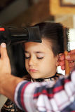 Young boy at barber shop Royalty Free Stock Photo