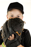 Young boy baseball pitcher peering over glove ready to pitch Royalty Free Stock Photography