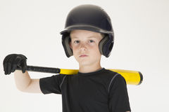 Young boy baseball player resting bat on his shoulder intense fa Stock Image